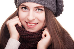 Girl smiling at camera in winter scarf Royalty Free Stock Images