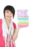 A girl smiling with carrying pile of presents Royalty Free Stock Photos