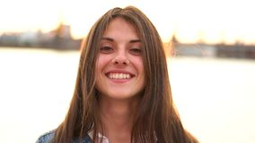 Girl smiling on the city waterfront stock footage