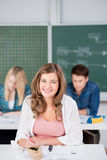 Girl Smiling With Classmates In Background Stock Images
