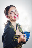 Girl smiling with cup of hot beverage Royalty Free Stock Image