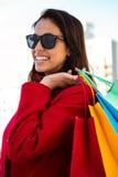 Girl smiling doing her shopping Stock Photos