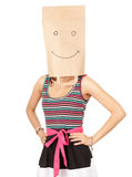 Girl in smiling ecological paper bag on head Royalty Free Stock Photography