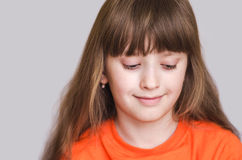Girl smiling eyes lowered down Royalty Free Stock Image