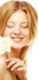 Girl smiling and with flower narcissus Stock Images