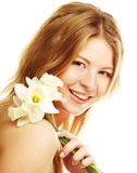 Girl smiling and with flower narcissus Stock Photos