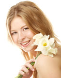 Girl smiling and with flower narcissus Royalty Free Stock Photo