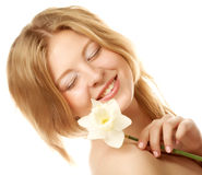 Girl smiling and with flower narcissus Stock Image