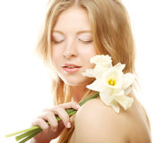 Girl smiling and with flower narcissus Royalty Free Stock Image