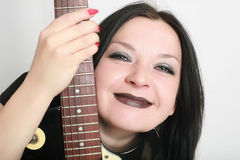 Girl smiling with guitar isolated Stock Images