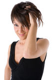 Girl smiling with hand between the hair Royalty Free Stock Photography