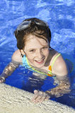 Girl smiling and happy in the pool in summer Royalty Free Stock Photo