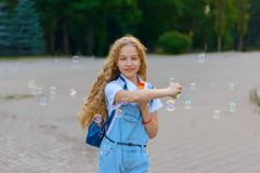 Girl smiling and happy to blow bubbles royalty free stock photos