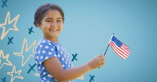 Girl smiling and holding american flag against blue background with hand drawn star pattern Royalty Free Stock Photos