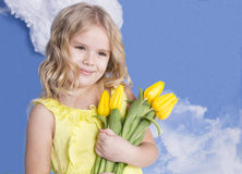Girl smiling and holding a bouquet of flowers Stock Photos