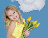 Girl smiling and holding a bouquet of flowers Stock Images