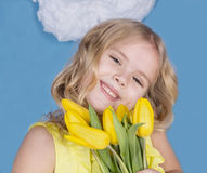 Girl smiling and holding a bouquet of flowers Royalty Free Stock Photography