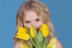 Girl smiling and holding a bouquet of flowers Royalty Free Stock Image