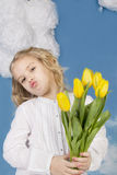 Girl smiling and holding a bouquet of tulips Stock Images