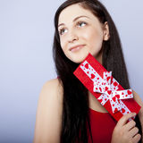 girl smiling holds a gift Royalty Free Stock Photography