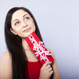 Girl smiling holds a gift Royalty Free Stock Image