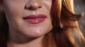 Broad happy smile of adult woman, macro shot of mouth stock footage