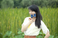 Girl smiling on the lens Stock Photo