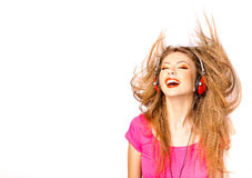 Girl smiling while listening music on headphones Stock Images