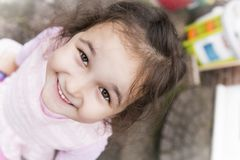 Girl smiling. Little girl with a lovely smile on her face Royalty Free Stock Image