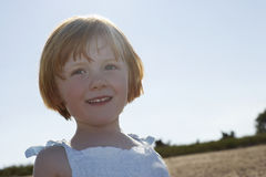 Girl Smiling While Looking Away At Beach Royalty Free Stock Photography