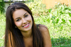 Girl smiling lying on the grass. Royalty Free Stock Photography