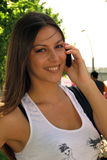 Girl smiling with mobile talking Royalty Free Stock Images