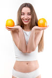 Girl smiling with oranges Royalty Free Stock Images