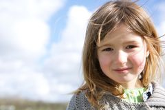 Girl smiling outdoors Royalty Free Stock Image
