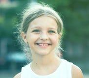 Girl smiling outdoors Stock Photos