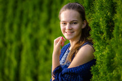 Girl. A smiling girl over green background Stock Photo