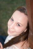Girl smiling over her shoulder Stock Photography