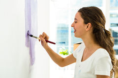 Girl smiling and painting Royalty Free Stock Photos