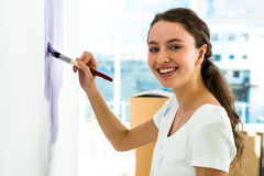 Girl smiling and painting Stock Photography