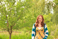 Girl smiling in the park Stock Images