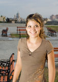 Girl smiling in a park, in Havana City. Girl smiling in a park, with Havana City background, Cuba Stock Images
