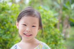 Girl smiling in park Royalty Free Stock Image