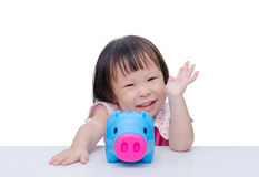 Girl smiling with piggy bank Stock Image