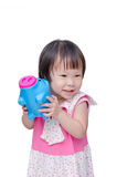 Girl smiling with piggy bank Royalty Free Stock Image
