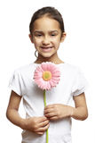 Girl smiling with pink flower Royalty Free Stock Image