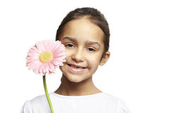 Girl smiling with pink flower Royalty Free Stock Photo