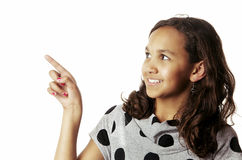 Girl smiling and pointing to side Stock Image