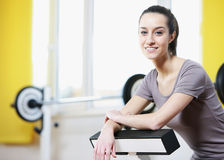 Girl is smiling and resting in a gym. Royalty Free Stock Photo