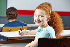 Girl smiling in school class Royalty Free Stock Photos