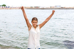 Girl smiling on sea beach Royalty Free Stock Photography
